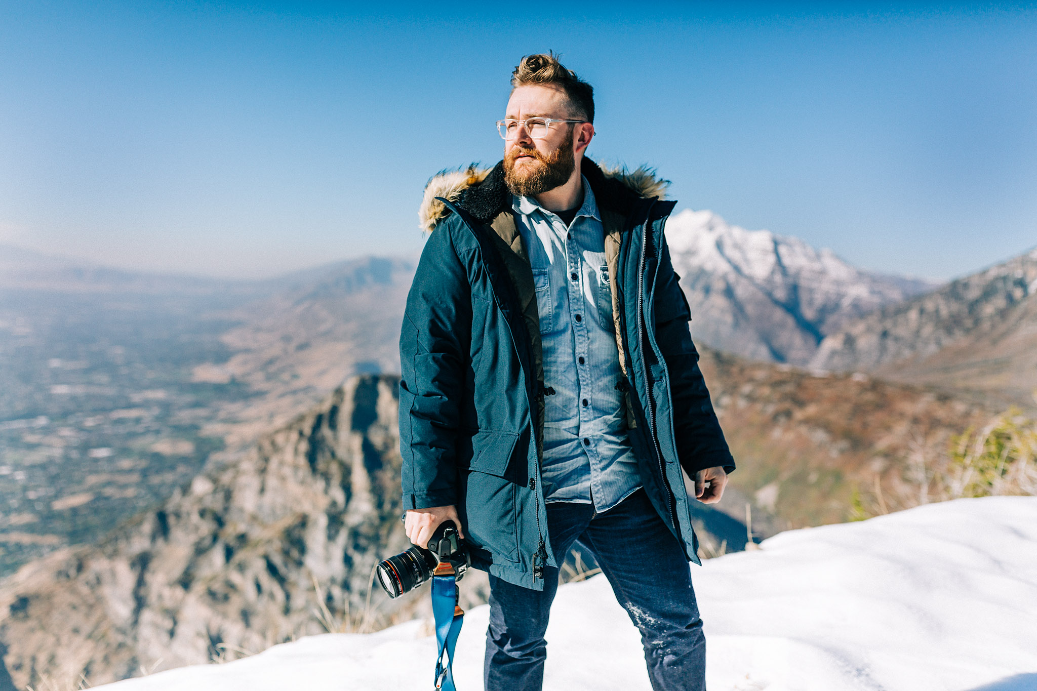 atop a mountain in the JCrew Nordic Down Parka